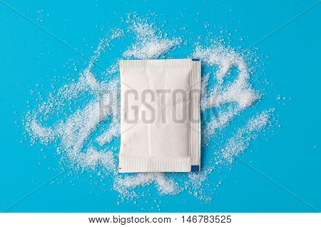 White Sugar Packets on a Blue background.