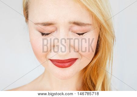 Portrait of carroty crying woman. Red-haired sad girl with closed eyes and sad facial expression closeup. Relationship or family issues. Sadness, sorrow, grief concept.