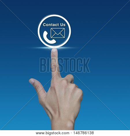 Hand pressing telephone and mail icon button over blue background Contact us concept