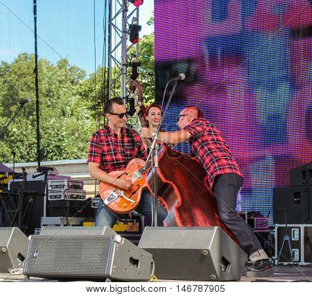 St. Petersburg, Russia - 12 August, The trio of musicians with instruments,12 August, 2016. Pop and rock musicians on Harley Davidson festival in St. Petersburg.