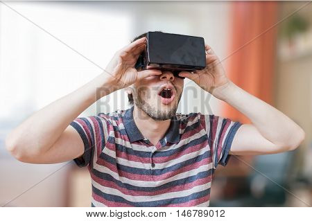 Man Is Wearing 3D Virtual Reality Headset And Is Fascinated.