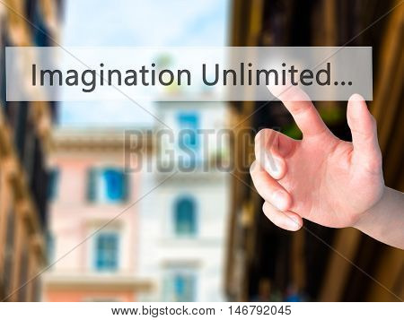 Imagination Unlimited... - Hand Pressing A Button On Blurred Background Concept On Visual Screen.