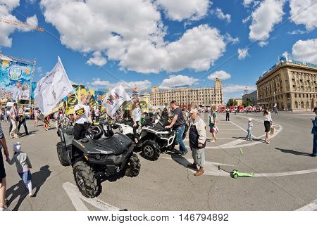 Girls Advertise Atvs Off-road At The Exhibition Of Motorcycles Under The Open Sky