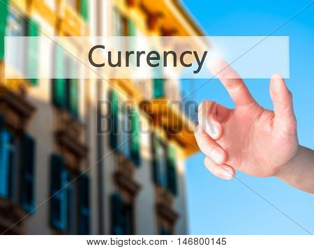 Currency - Hand Pressing A Button On Blurred Background Concept On Visual Screen.