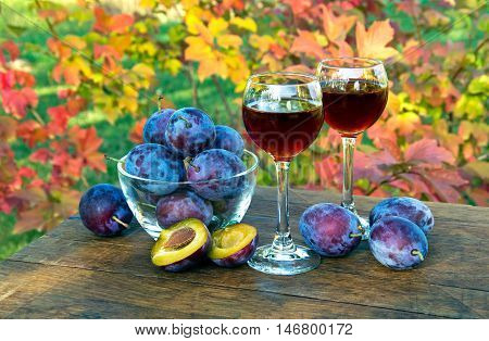 Plum Drink In A Glass Wineglass On A Sunny Day