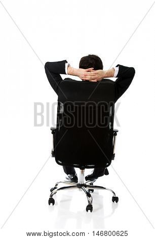 Young businessman sesting on a chair.