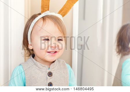 Happy Toddler Girl Playing With Costume Ears