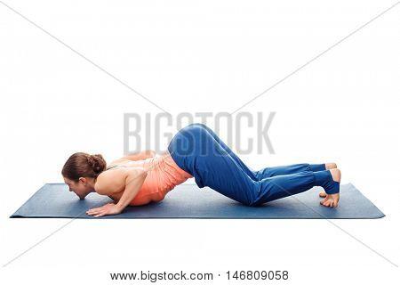 Woman doing Hatha yoga asana Ashtangasana - eight-limbed pose posture isolated on white background