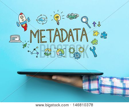 Metadata concept with a tablet on blue background