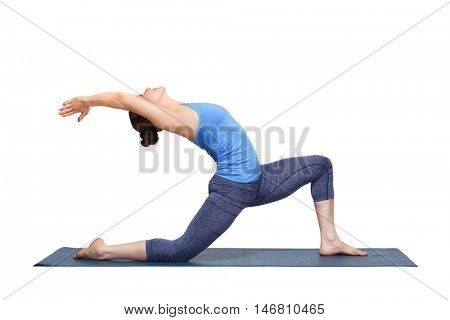 Beautiful sporty fit yogini woman practices yoga asana  Anjaneyasana - low crescent lunge pose in surya namaskar in studio isolated on white