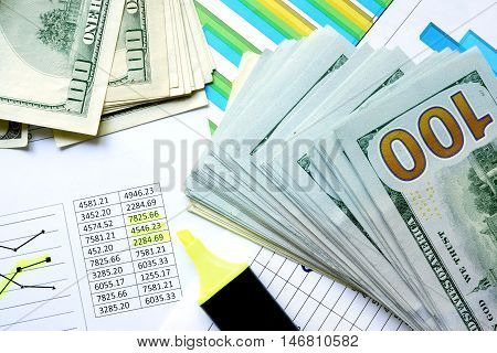 Money with colorful charts and marker. Finance concept.