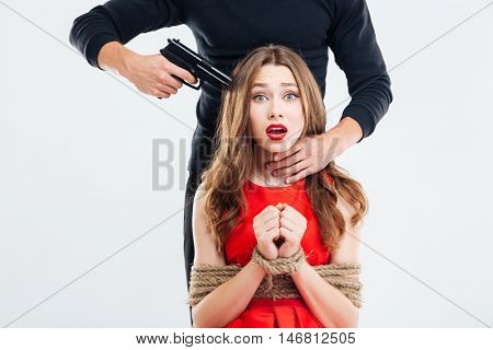 Criminal man put gun to the temple of beautiful woman