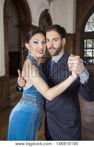 Confident Tango Dancers Performing In Restaurant
