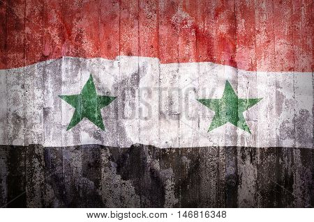Grunge Style Of Syria Flag On A Brick Wall