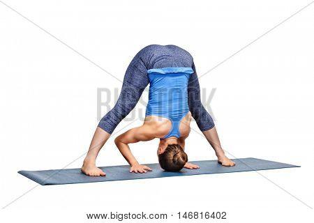 Beautiful sporty fit woman practices Ashtanga Vinyasa yoga asana Prasarita padottanasana A - wide legged forward bend A isolated on white