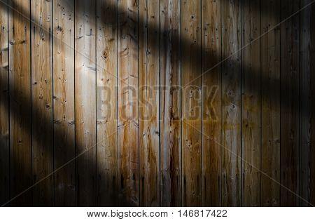 Light beam on a dark wooden background