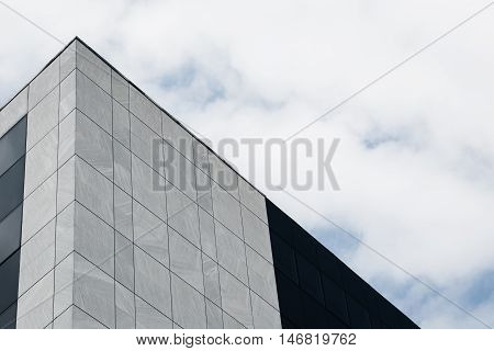 Architectural detail of a modern building against cloudy sky