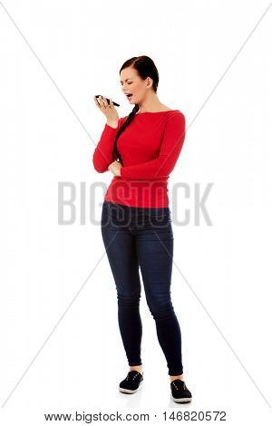 Young student woman yelling to the mobile phone