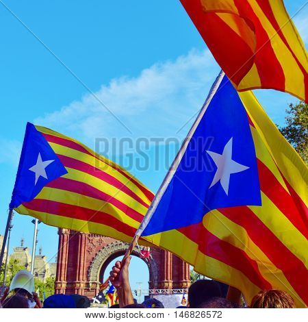unrecognizable people partaking in a rally in support for the independence of Catalonia in Barcelona, Spain, during the National Day of Catalonia