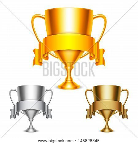 Golden, silver and bronze trophy cups with ribbons