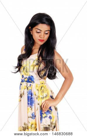 A beautiful young Indian woman standing from front with her long black hair waist up isolated for white background.