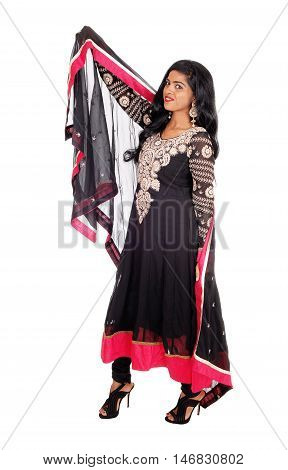 A beautiful Indian woman in a native black dress and long black hair standing isolated for white background.