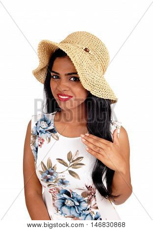 A beautiful woman with a beige straw hat and long black hair looking into the camera isolated for white background.