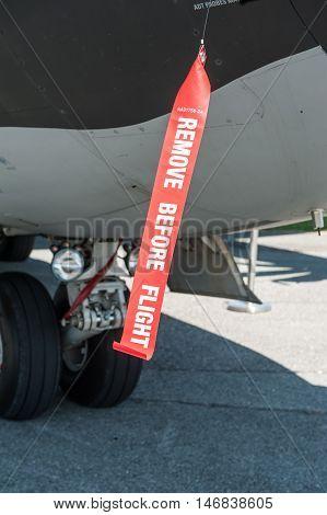 Big militar plane parking with red warning
