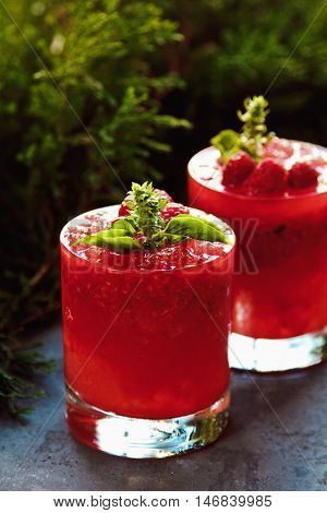 Alcoholic Cocktail Raspberry Cobbler With Mint Leaves On A Dark Background