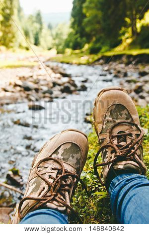 Hiking Shoes On Hiker Walking Outdoors. Men On Trekking In Nature. Close Up Of Hiking Boots.