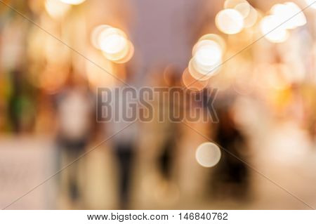 Abstract blurred background of people walking in the dusk