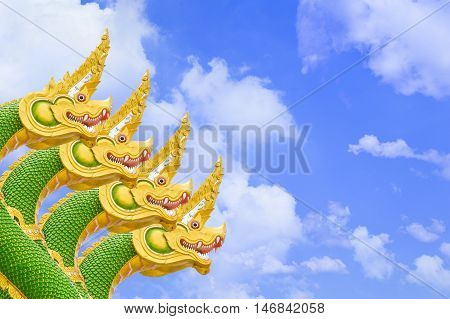 close up Four King of Nagas statue on blue sky