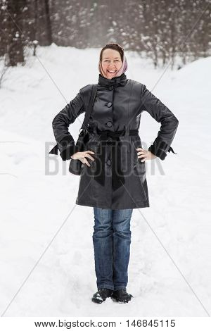 Portrait of woman standing against a winter forest
