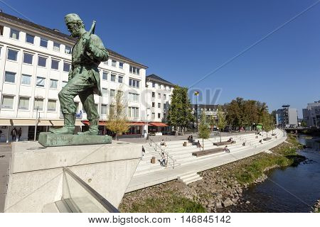 SIEGEN GERMANY - SEP 8 2016: Miner statue at the Sieg river in the city of Siegen. North Rhine-Westphalia Germany