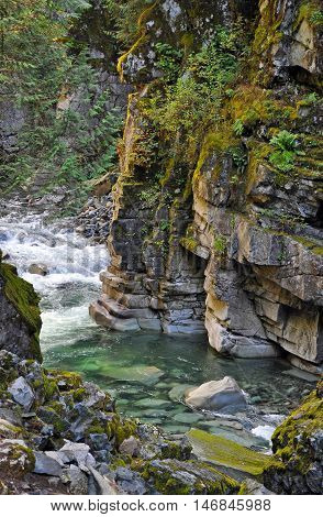 Crystal clear river flowing through Coquihalla Canyon in Canada