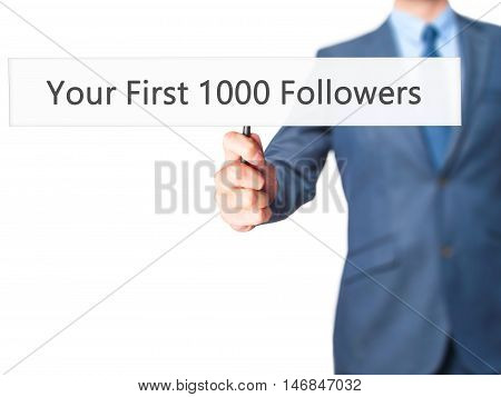 Your First 1000 Followers - Businessman Hand Holding Sign