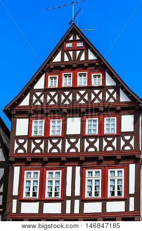 Red and Brown half-timbered house in historic town Alsfeld, Germany