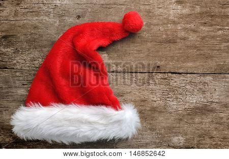 santa fur cap on a rustic wooden background