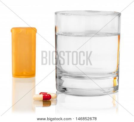 Pill Bottle and Capsules with Glass of Water