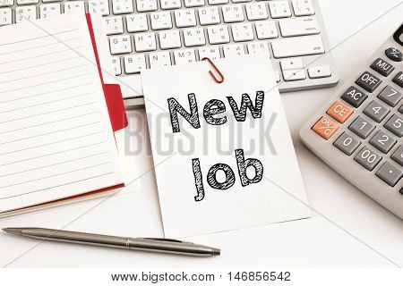 Word text New job on white paper card on office table / business concept