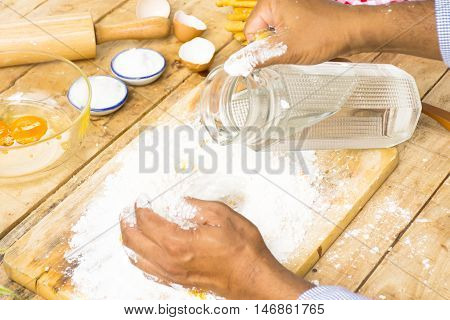 bake, baker, bakery, bread, chef, child, close, coat, cook, cooking, cuisine, dough, egg, flour, food, fresh, hand, handmade, home, homemade, ingredient, kitchen, knead, kneading, loaf, make, man, pastry, people, person, preparation, prepare, raw, restaur