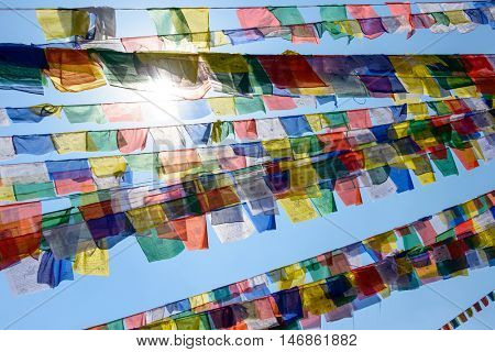 Backlit prayer flags in Nepal