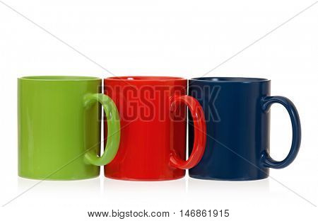 Three color coffee cups - red, green and blue, isolated on white background. Set of ceramic motley mugs for tea with clipping path.