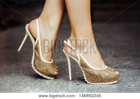 beige shoes female fancy high heel pumps strappy sandals on woman legs beautiful feet