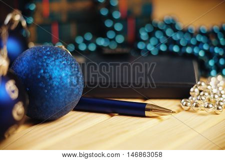 Christmas balls and ballpoint pen on a table