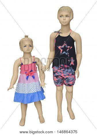 Two mannequins dressed in summer fashion for children. Isolated on white background. No brand names or copyright objects.