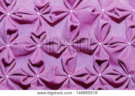 Textile in interior. Purple abstract fabric background.