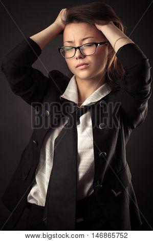 Korean teen girl in business suit holding hands hair
