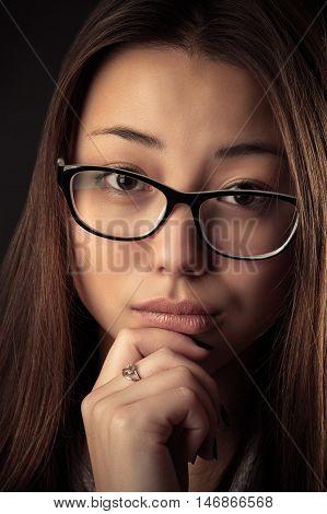 portrait Korean beautiful pensive teenager girl isolated on black background