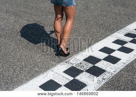 Woman Sexy Legs On Motorsport Asphalt Track